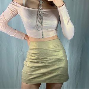 Beautiful gold EXPRESS mini skirt
